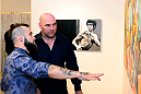 LAS VEGAS, NV - JULY 1:  (L-R) Artist Brian Kirhagis showcases his artwork to UFC President Dana White at the Art of Fighting Exhibition to kick off the UFC International Fight Week at The Gallery on 1217 on July 1, 2014 in Las Vegas, Nevada. (Photo by Jeff Bottari/Zuffa LLC/Zuffa LLC via Getty Images)