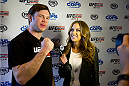 LAS VEGAS, NV - JULY 2:  UFC legend Forrest Griffin (L) is interviewed by UFC Octagon Girl Brittney Palmer at the advanced screening of the Twentieth Century Fox film 'Let's Be Cops' during UFC International Fight Week at Brooklyn Bowl Las Vegas at The LINQ on July 2, 2014 in Las Vegas, Nevada. (Photo by Al Powers/Zuffa LLC/Zuffa LLC via Getty Images)