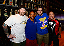 LAS VEGAS, NV - JULY 2: UFC Flyweight Champion Demetrious 'Mighty Mouse' Johnson poses with fans during the UFC International Fight Week charity bowling event at Brooklyn Bowl Las Vegas at The LINQ on July 2, 2014 in Las Vegas, Nevada. (Photo by Brandon Magnus/Zuffa LLC/Zuffa LLC via Getty Images)
