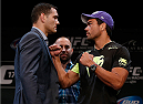 LAS VEGAS, NV - JULY 03:  (L-R) Opponents Chris Weidman and Lyoto Machida face off during the UFC Ultimate Media Day at the Mandalay Bay Resort and Casino on July 3, 2014 in Las Vegas, Nevada.  (Photo by Josh Hedges/Zuffa LLC/Zuffa LLC via Getty Images)