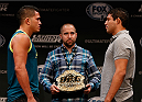 LAS VEGAS, NV - JULY 03:  (L-R) UFC lightweight champion Anthony Pettis and upcoming opponent Gilbert Melendez face off during the UFC Ultimate Media Day at the Mandalay Bay Resort and Casino on July 3, 2014 in Las Vegas, Nevada.  (Photo by Josh Hedges/Zuffa LLC/Zuffa LLC via Getty Images)