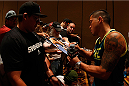 LAS VEGAS, NV - JULY 03:  UFC lightweight champion Anthony Pettis signs autographs during the UFC Ultimate Media Day at the Mandalay Bay Resort and Casino on July 3, 2014 in Las Vegas, Nevada.  (Photo by Josh Hedges/Zuffa LLC/Zuffa LLC via Getty Images)