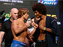 LAS VEGAS, NV - JULY 04:  (L-R) Urijah Faber faces off with Alex Caceres during the UFC 175 weigh-in inside the Mandalay Bay Events Center on July 4, 2014 in Las Vegas, Nevada.  (Photo by Josh Hedges/Zuffa LLC/Zuffa LLC via Getty Images)