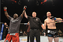 LAS VEGAS, NV - JULY 05:  (L-R) Kevin Casey celebrates after defeating Bubba Bush in their middleweight fight at UFC 175 inside the Mandalay Bay Events Center on July 5, 2014 in Las Vegas, Nevada.  (Photo by Donald Miralle/Zuffa LLC/Zuffa LLC via Getty Images)
