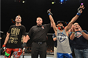 LAS VEGAS, NV - JULY 05:  (R-L) Rob Font celebrates defeating George Roop in their bantamweight fight at UFC 175 inside the Mandalay Bay Events Center on July 5, 2014 in Las Vegas, Nevada.  (Photo by Donald Miralle/Zuffa LLC/Zuffa LLC via Getty Images)
