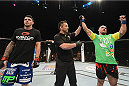 LAS VEGAS, NV - JULY 05:  (R-L) Bruno Santos celebrates after defeating Chris Camozzi in their middleweight fight at UFC 175 inside the Mandalay Bay Events Center on July 5, 2014 in Las Vegas, Nevada.  (Photo by Donald Miralle/Zuffa LLC/Zuffa LLC via Getty Images)