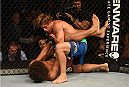 LAS VEGAS, NV - JULY 05:  Urijah Faber (top) grapples with Alex Caceres in their bantamweight fight at UFC 175 inside the Mandalay Bay Events Center on July 5, 2014 in Las Vegas, Nevada.  (Photo by Donald Miralle/Zuffa LLC/Zuffa LLC via Getty Images)