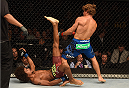 LAS VEGAS, NV - JULY 05:  (L-R) Alex Caceres attempts an up-kick on Urijah Faber in their bantamweight fight at UFC 175 inside the Mandalay Bay Events Center on July 5, 2014 in Las Vegas, Nevada.  (Photo by Donald Miralle/Zuffa LLC/Zuffa LLC via Getty Images)