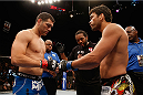 LAS VEGAS, NV - JULY 05:  (L-R) UFC middleweight champion Chris Weidman touches gloves with Lyoto Machida before their UFC middleweight championship fight at UFC 175 inside the Mandalay Bay Events Center on July 5, 2014 in Las Vegas, Nevada.  (Photo by Josh Hedges/Zuffa LLC/Zuffa LLC via Getty Images)