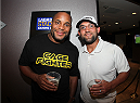 LAS VEGAS, NV - JULY 1:  (R-L)  UFC Welterweight Champ Johnny Hendricks and Daniel Cormier watch the 2014 FIFA World Cup Brazil Round of 16 match between USA and Belgium with fans to kick off the UFC International Fight Week at Legasse's Stadium at The Palazzo Las Vegas on July 1, 2014 in Las Vegas, Nevada. (Photo by Brandon Magnus/Zuffa LLC/Zuffa LLC via Getty Images)