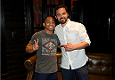 LAS VEGAS, NV - JULY 2:  Mixed martial artist John Dodson (L) and actor Jake Johnson interact at the UFC LINQ High Roller charity auction takeover during UFC International Fight Week at The Las Vegas High Roller at The LINQ on July 2, 2014 in Las Vegas, Nevada. (Photo by Al Powers/Zuffa LLC/Zuffa LLC via Getty Images) *** Local Caption *** John Dodson;Jake Johnson