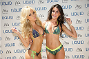 LAS VEGAS, NV - JULY 3:  UFC Octagon Girls Jhenny Andrade (L) and Camila Rodrigues de Oliveira arrives at the UFC pool party during UFC International Fight Week at the Liquid Pool Lounge at the Aria Resort & Casino at CityCenter on July 3, 2014 in Las Vegas, Nevada. (Photo by Al Powers/Zuffa LLC/Zuffa LLC via Getty Images) *** Local Caption *** Jhenny Andrade;Camila Rodrigues de Oliveira