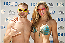 LAS VEGAS, NV - JULY 3:  Mixed martial artists Brian Caraway (L) and Miesha Tate arrive at the UFC pool party during UFC International Fight Week at the Liquid Pool Lounge at the Aria Resort & Casino at CityCenter on July 3, 2014 in Las Vegas, Nevada. (Photo by Al Powers/Zuffa LLC/Zuffa LLC via Getty Images) *** Local Caption *** Brian Caraway;Miesha Tate