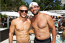 LAS VEGAS, NV - JULY 3:  UFC bantamweight champion TJ Dillashaw (L) and welterweight champion Johny Hendricks pose at the UFC pool party during UFC International Fight Week at the Liquid Pool Lounge at the Aria Resort & Casino at CityCenter on July 3, 2014 in Las Vegas, Nevada. (Photo by Al Powers/Zuffa LLC/Zuffa LLC via Getty Images)