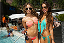 LAS VEGAS, NV - JULY 3:  UFC Octagon Girls Brittney Palmer (L) and Arianny Celeste pose at the UFC pool party during UFC International Fight Week at the Liquid Pool Lounge at the Aria Resort & Casino at CityCenter on July 3, 2014 in Las Vegas, Nevada. (Photo by Al Powers/Zuffa LLC/Zuffa LLC via Getty Images) *** Local Caption *** Brittney Palmer;Arianny Cleste