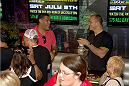 LAS VEGAS, NV - JULY 3:  Mixed martial artists Antonio 'Bigfoot' Silva (L) and Junior Dos Santos interact at the UFC Brazilian party during UFC International Fight Week inside the Rockhouse at The Venetian Las Vegas on July 3, 2014 in Las Vegas, Nevada. (Photo by Al Powers/Zuffa LLC/Zuffa LLC via Getty Images) *** Local Caption *** Antonio Silva;Junior Dos Santos
