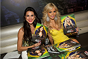 LAS VEGAS, NV - JULY 3:  UFC Octagon Girls Camila Rodrigues de Oliveira (L) and Jhenny Andrade sign autographs for fans at the UFC Brazilian party during UFC International Fight Week inside the Rockhouse at The Venetian Las Vegas on July 3, 2014 in Las Vegas, Nevada. (Photo by Al Powers/Zuffa LLC/Zuffa LLC via Getty Images) *** Local Caption *** Camila Rodrigues de Oliveira;Jhenny Andrade