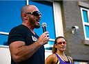 LAS VEGAS, NV - JULY 4:  Mike Dolce and Miesha Tate help the participants warm up before the first annual Ulti-man 5K run during UFC International Fight Week at Hogs and Heifers on July 4, 2014 in Las Vegas, Nevada. Proceeds will help support Three Square Food Bank. (Photo by Brandon Magnus/Zuffa LLC/Zuffa LLC via Getty Images)