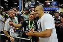 LAS VEGAS, NV - JULY 5:  Mixed martial artist Chuck Liddell poses with a fan during the UFC Fan Expo at the Mandalay Bay Convention Center on July 5, 2014 in Las Vegas, Nevada. (Photo by Todd Lussier/Zuffa LLC/Zuffa LLC via Getty Images) *** Local Caption ***Chuck Liddell