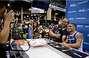 LAS VEGAS, NV - JULY 6: UFC featherweight star Chad Mendes poses for photos with fans at the UFC Fan Expo 2014 during UFC International Fight Week at the Mandalay Bay Convention Center on July 6, 2014 in Las Vegas, Nevada. (Photo by Isaac Brekken/Zuffa LLC/Zuffa LLC via Getty Images)