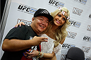LAS VEGAS, NV - JULY 6: Octagon girl Jhenny Andrade poses for photos with fans at the UFC Fan Expo 2014 during UFC International Fight Week at the Mandalay Bay Convention Center on July 6, 2014 in Las Vegas, Nevada. (Photo by Isaac Brekken/Zuffa LLC/Zuffa LLC via Getty Images)