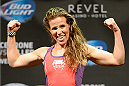ATLANTIC CITY, NJ - JULY 15:  Leslie Smith steps on the scale during the UFC Fight Night weigh-in at Revel Casino on July 15, 2014 in Atlantic City, New Jersey.  (Photo by Jeff Bottari/Zuffa LLC/Zuffa LLC via Getty Images)
