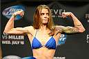 ATLANTIC CITY, NJ - JULY 15:  Jessamyn Duke steps on the scale during the UFC Fight Night weigh-in at Revel Casino on July 15, 2014 in Atlantic City, New Jersey.  (Photo by Jeff Bottari/Zuffa LLC/Zuffa LLC via Getty Images)