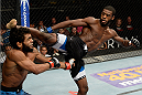 ATLANTIC CITY, NJ - JULY 16: (R-L) Aljamain Sterling kicks Hugo Viana in their bantamweight bout during the UFC Fight Night event at Revel Casino on July 16, 2014 in Atlantic City, New Jersey. (Photo by Jeff Bottari/Zuffa LLC/Zuffa LLC via Getty Images)