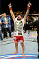 ATLANTIC CITY, NJ - JULY 16: John Lineker celebrates after defeating Alptekin Ozkilic in their flyweight bout during the UFC Fight Night event at Revel Casino on July 16, 2014 in Atlantic City, New Jersey. (Photo by Jeff Bottari/Zuffa LLC/Zuffa LLC via Getty Images)