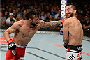 ATLANTIC CITY, NJ - JULY 16: (L-R) John Lineker punches Alptekin Ozkilic in their flyweight bout during the UFC Fight Night event at Revel Casino on July 16, 2014 in Atlantic City, New Jersey. (Photo by Jeff Bottari/Zuffa LLC/Zuffa LLC via Getty Images)