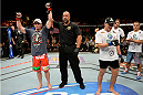 ATLANTIC CITY, NJ - JULY 16:  (L-R) Rick Story celebrates after submitting Leonardo Mafra in their welterweight bout during the UFC Fight Night event at Revel Casino on July 16, 2014 in Atlantic City, New Jersey. (Photo by Jeff Bottari/Zuffa LLC/Zuffa LLC via Getty Images)