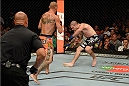 "ATLANTIC CITY, NJ - JULY 16: (L-R) Donald ""Cowboy"" Cerrone knocks down Jim Miller with a head kick in their lightweight bout during the UFC Fight Night event at Revel Casino on July 16, 2014 in Atlantic City, New Jersey. (Photo by Jeff Bottari/Zuffa LLC/Zuffa LLC via Getty Images)"