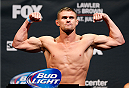 SAN JOSE, CA - JULY 25:  Daron Cruickshank poses on the scale after making weight during the UFC fight night weigh-in at the SAP Center on July 25, 2014 in San Jose, California.  (Photo by Josh Hedges/Zuffa LLC/Zuffa LLC via Getty Images)