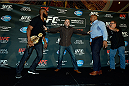 LAS VEGAS, NV - AUG 4:  (L-R) UFC light heavyweight champion Jon Jones and challenger Daniel Cormier are separated after facing off during the UFC 178 Ultimate Media Day at the MGM Grand Hotel/Casino on August 4, 2014 in Las Vegas, Nevada. (Photo by Jeff Bottari/Zuffa LLC/Zuffa LLC via Getty Images)