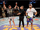 BANGOR, ME - AUGUST 16:  (L-R) Tim Boetsch celebrates after defeating Brad Tavares in their middleweight bout during the UFC fight night event at the Cross Insurance Center on August 16, 2014 in Bangor, Maine. (Photo by Jeff Bottari/Zuffa LLC/Zuffa LLC via Getty Images)