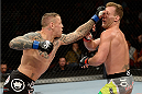 BANGOR, ME - AUGUST 16:  (L-R) Ross Pearson punches Gray Maynard in their lightweight bout during the UFC fight night event at the Cross Insurance Center on August 16, 2014 in Bangor, Maine. (Photo by Jeff Bottari/Zuffa LLC/Zuffa LLC via Getty Images)