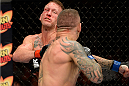 BANGOR, ME - AUGUST 16:  (R-L) Ross Pearson knocks out Gray Maynard in their lightweight bout during the UFC fight night event at the Cross Insurance Center on August 16, 2014 in Bangor, Maine. (Photo by Jeff Bottari/Zuffa LLC/Zuffa LLC via Getty Images)