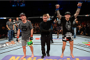 BANGOR, ME - AUGUST 16:  (R-L) Ross Pearson celebrates after knocking out Gray Maynard in their lightweight bout during the UFC fight night event at the Cross Insurance Center on August 16, 2014 in Bangor, Maine. (Photo by Jeff Bottari/Zuffa LLC/Zuffa LLC via Getty Images)