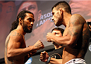 TULSA, OK - AUGUST 22: (L-R) Opponents Benson Henderson and Rafael dos Anjos of Brazil face off during the UFC Fight Night weigh-in at the BOK Center on August 22, 2014 in Tulsa, Oklahoma. (Photo by Mike Roach/Zuffa LLC/Zuffa LLC via Getty Images)