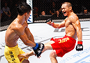 MACAU - AUGUST 23:  Ning Guangyou kicks Yang Jianping in their featherweight fight during the UFC Fight Night event at the Venetian Macau on August 23, 2014 in Macau. (Photo by Mitch Viquez/Zuffa LLC/Zuffa LLC via Getty Images)