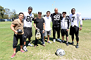 ALAMEDA, CA - AUGUST 26:  (L-R) UFC flyweight Joseph Benavidez, Raiders wide receiver Rod Streater, bantamweight champion TJ Dillashaw, lightweight Gilbert Melendez, defensive end Jack Crawford, Dan Marks and punter Marquette Lee interact at the Oakland Raiders training facility on August 26, 2014 in Alameda, California. (Photo by Jeff Bottari/Zuffa LLC/Zuffa LLC via Getty Images)