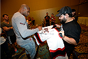 MASHANTUCKET, CT - SEPTEMBER 3:  Alistair Overeem signs autographs for fans during a media availability at the Foxwoods Resort Casino on September 3, 2014 in Mashantucket, Connecticut. (Photo by Jeff Bottari/Zuffa LLC/Zuffa LLC via Getty Images)