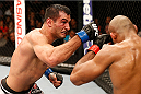 MASHANTUCKET, CT - SEPTEMBER 05:  (L-R) Gegard Mousasi punches Ronaldo 'Jacare' Souza in their middleweight bout during the UFC Fight Night event at Foxwoods Resort Casino on September 5, 2014 in Mashantucket, Connecticut.  (Photo by Josh Hedges/Zuffa LLC/Zuffa LLC via Getty Images)