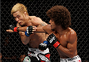 SAITAMA, JAPAN - SEPTEMBER 20: Alex Caceres throws a punch at Masanori Kanehara in their bantamweight bout during the UFC Fight Night event inside the Saitama Arena on September 20, 2014 in Saitama, Japan. (Photo by Mitch Viquez/Zuffa LLC/Zuffa LLC via Getty Images)