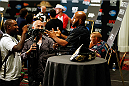LAS VEGAS, NV - SEPTEMBER 25:  Demetrious Johnson interacts with media during the UFC 178 Ultimate Media Day at the MGM Grand Hotel/Casino on September 25, 2014 in Las Vegas, Nevada. (Photo by Josh Hedges/Zuffa LLC/Zuffa LLC via Getty Images)
