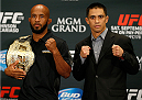 LAS VEGAS, NV - SEPTEMBER 25:  (L-R) Opponents Demetrious Johnson and Chris Cariaso pose for photos during the UFC 178 Ultimate Media Day at the MGM Grand Hotel/Casino on September 25, 2014 in Las Vegas, Nevada. (Photo by Josh Hedges/Zuffa LLC/Zuffa LLC via Getty Images)