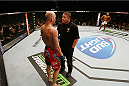 LAS VEGAS, NV - SEPTEMBER 27:  (L-R) Brian Ebersole is given a warning for an illegal upkick against John Howard in their welterweight fight during the UFC 178 event inside the MGM Grand Garden Arena on September 27, 2014 in Las Vegas, Nevada.  (Photo by Josh Hedges/Zuffa LLC/Zuffa LLC via Getty Images)