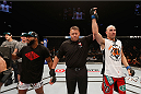 LAS VEGAS, NV - SEPTEMBER 27:  (R-L) Brian Ebersole celebrates his split decision win over John Howard after their welterweight fight during the UFC 178 event inside the MGM Grand Garden Arena on September 27, 2014 in Las Vegas, Nevada.  (Photo by Josh Hedges/Zuffa LLC/Zuffa LLC via Getty Images)