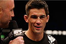 LAS VEGAS, NV - SEPTEMBER 27:  Dominick Cruz speaks with Joe Rogan after his TKO victory over Takeya Mizugaki in their bantamweight fight during the UFC 178 event inside the MGM Grand Garden Arena on September 27, 2014 in Las Vegas, Nevada.  (Photo by Josh Hedges/Zuffa LLC/Zuffa LLC via Getty Images)