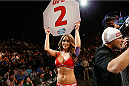 LAS VEGAS, NV - SEPTEMBER 27:  UFC Octagon Girl Brittney Palmer announces round 2 of the flyweight championship fight during the UFC 178 event inside the MGM Grand Garden Arena on September 27, 2014 in Las Vegas, Nevada.  (Photo by Josh Hedges/Zuffa LLC/Zuffa LLC via Getty Images)